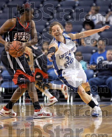 Near theft: Indiana State's #33, Kelsey Luna is denied a lose ball by an Arkansas State player during second half action at Hulman Center Tuesday night.