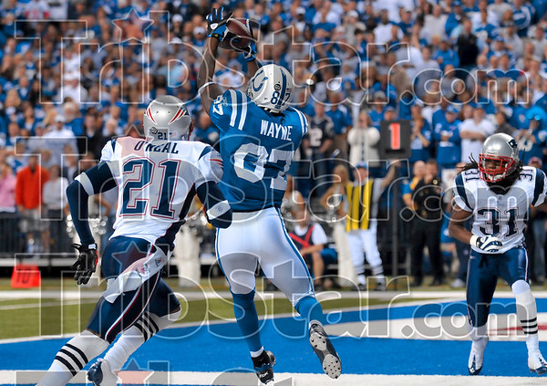 One catch, two points: Indianapolis Colts wide receiver Reggie Wayne catches a Peyton Mannning pass to score two points during the Colts' win over the Patriots Sunday in Indianapolis.