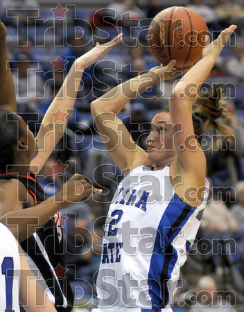 Score: Indiana State's #32, Kara Schilli pops in two points in the lane during first half action against Arkansas State Tuesday night at Hulman Center.
