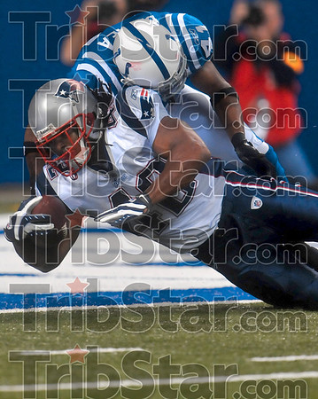 Breaking the plane: New England's BenJarvus Green-Ellis breaks the plane of the endzone to score during the Patriots' loss Sunday in Indianapolis.