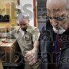 But before we go...: Dutch Gunyon, right, leads members of the Wabash Valley Correctional Facility' P.L.U.S. unit, including Randy O'Brien, left, in prayer before leaving the prison to deliver the packages the unit members put together Tuesday near Carlisle.