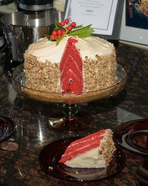 """12-06-08 <a href=""""http://jmearns.smugmug.com/gallery/6766034_JExUZ#432106371_Y8ZGa"""">Xmas Party</a> - Red Velvet Cake  From Paula Dean's grandmother's recipe <a href=""""http://www.foodnetwork.com/recipes/paula-deen/grandmother-pauls-red-velvet-cake-recipe/index.html"""">here</a>.  The frosting is NOT from this recipe. It's just a regular cream cheese frosting, with chopped pecans pressed into the sides.  YUMMY."""