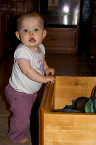Anna has not only discovered the tupperware drawer, but she can open it herself.