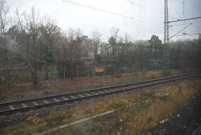 Taking the S-bahn to Frankfurt Hauptbahnhof.  Lots of German flags on the fence.