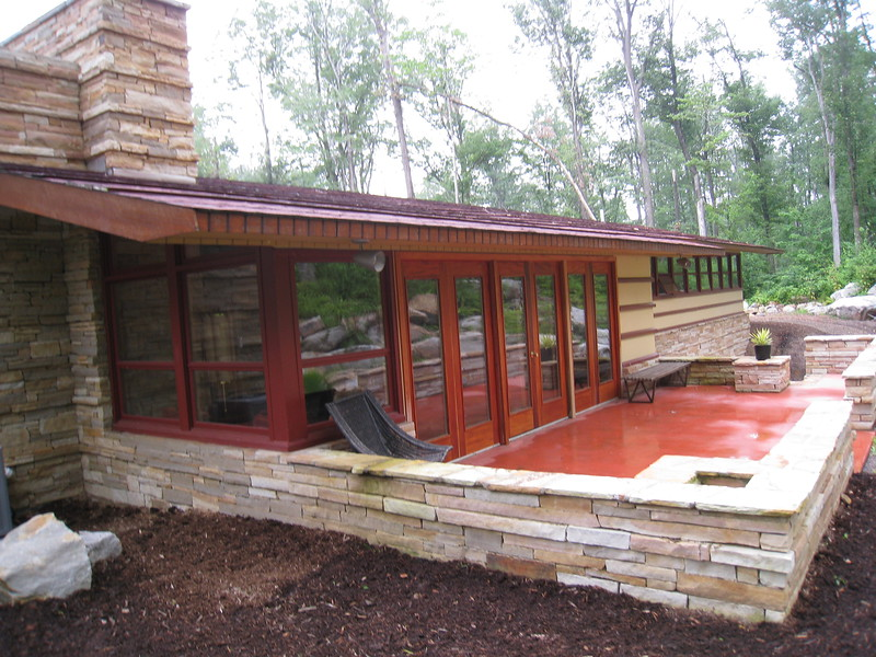 Duncan House: patio and glass wall of living room