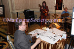 Jon Glass sketching Joseph Carter III Trio at Fountain Gallery's Seventh Annual Celebration of Life benefit, on November 10, 2008, at the Grand Hyatt New York 109 East 42nd Street <br /> (Photo Credit: Stuart Rinzler/ManhattanSociety.com)