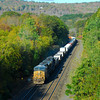 Eastbound CSX intermodal train heads down grade in Middlefield as the leaves are just begining to turn in the Berkshires.