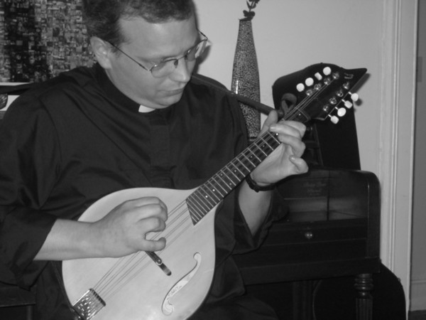 "<span style=""color:#ff3388"">Father Thomas Joseph plays the Mandolin</span>"
