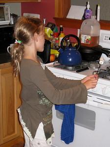 Leah roasts an indoor marshmallow