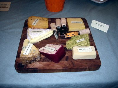 "Assorted vegetarian and vegan cheeses, clockwise from upper left: Gouda with Mustard Seed, Seaside English Cheddar, Sage Derby,  Vegan ""Monterey Jack,"" Wensleydale with Cranberries, Borough Market Stilton, and Fromager d'Affinois"