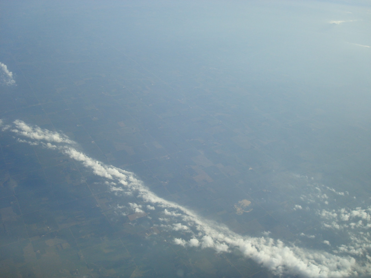 Somewhere over Ohio or thereabouts. Possibly a neighboring state.