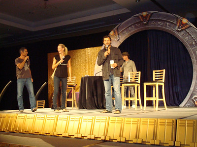 Cliff Simon (Ba'al), Andee Frizzell (Wraith queen), Steve Bacic (Camulus and Major Coburn), and Corin Nemec (Jonas) entering