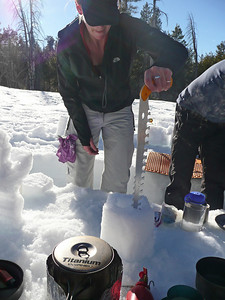 Kelly sculpting the lantern with a snow saw.