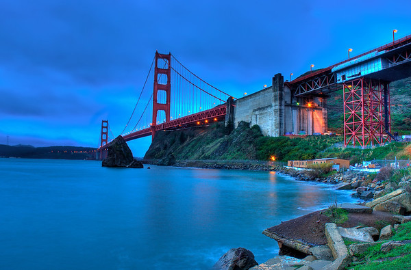 1st attempt at a cleaned up version of my GGB shot for HDRspotting.com. I ended up not liking this because there's way too much blue in this.  I got up early on Christmas morning with a friend and we drove up to San Francisco to photograph the Golden Gate Bridge. We got lucky and it was completely clear with no fog! This photo was taken from the pier at Horseshoe Bay, below the vista point.  Nikon D80 w/Nikkor 18-70mm f/3.5-4.5G ED-IF AF-S DX:  18 mm, ISO 125 4 images stitched together into an HDR using Photomatix Pro