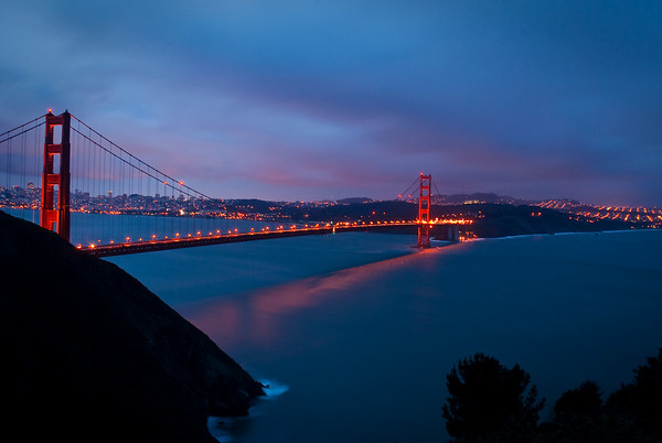SF Golden Gate Bridge at sundown. 30 second exposure made it blurry (at least this one isn't *awful*). Taken from the Marin Headlands.
