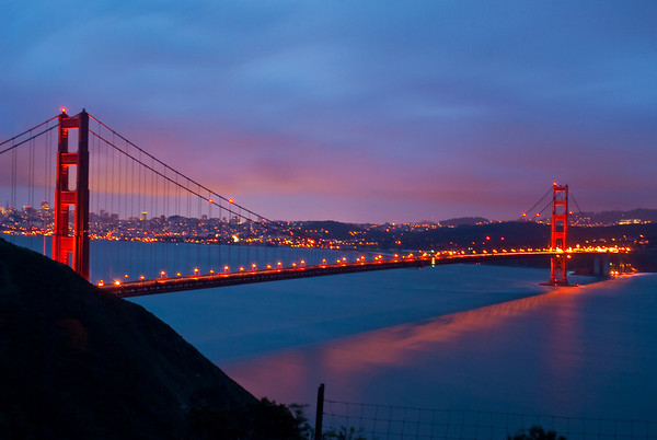 SF Golden Gate Bridge at sundown. 30 second exposure made it blurry :(. Taken from the Marin Headlands.