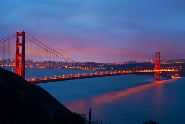 SF Golden Gate Bridge at sundown. 30 second exposure made it blurry :(. Taken from the Marin Headlands.