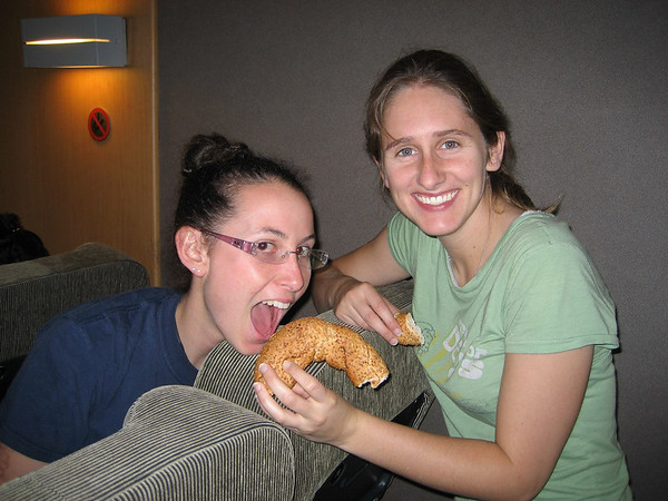 Jessica and Katy eating pretzels on the ferry from Athens to Syros.