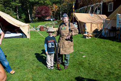 This kid was cute - the reenactor guy was great showing him all the stuff and letting him get his picture taken with some of the equipment.