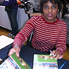 "Dr Sharon T. Freeman autographing the book ""African Americans Reviving Baseball in Inner Cities"""