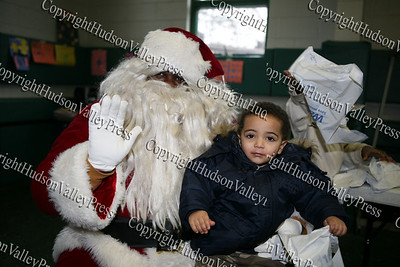 Aaron Garnar, dressed up as Santa, with two-year-old Jazziah Whitted who attended the Hebron Lodge #48 annual Christmas party at the Beacon Community Center on Saturday, December 27, 2008.