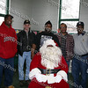 Aaron Garnar, dressed up as Santa, is surrounded by Hebron Lodge #48 brothers, Fred Calhoun, Dougles Bell, Bryan Hunt, Floyd Lewis, and Rodney Miller at the Beacon Community Center on Saturday, December 27, 2008.