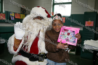 Aaron Garnar, dressed up as Santa, with six-year-old Tzipporah, who attended the Hebron Lodge #48 annual Christmas party at the Beacon Community Center on Saturday, December 27, 2008.