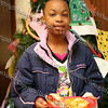 Ni' Asia enjoys a hot dog and chips while attending the Hebron Lodge #48 annual Christmas party at the Beacon Community Center on Saturday, December 27, 2008.