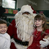 Aaron Garnar, dressed up as Santa, with four-year-old Dominic and four-year-old Bianca, who attended the Hebron Lodge #48 annual Christmas party at the Beacon Community Center on Saturday, December 27, 2008.
