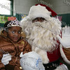 Aaron Garnar, dressed up as Santa, with three-year-old Nia, who attended the Hebron Lodge #48 annual Christmas party at the Beacon Community Center on Saturday, December 27, 2008.