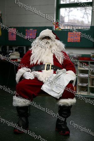 Aaron Garnar dressed up as Santa for the children who attended the Hebron Lodge #48 annual Christmas party at the Beacon Community Center on Saturday, December 27, 2008.