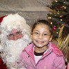 Chasity sits with Santa Claus during the City of Newburgh Christmas Extravaganza held at the Business Resource Center on December 12, 2008.