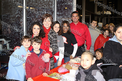 State Farm agents pose with staff and children gathered at their table during the City of Newburgh Christmas Extravaganza held at the Business Resource Center on December 12, 2008.