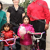 State Farm agents Sue Zaleski and Steve Cooney pose with three-year-old Margarita Agrados and five-year-old Jalynn Salazar who received bicycles they donated for the City of Newburgh Christmas Extravaganza held at the Business Resource Center on December 12, 2008.