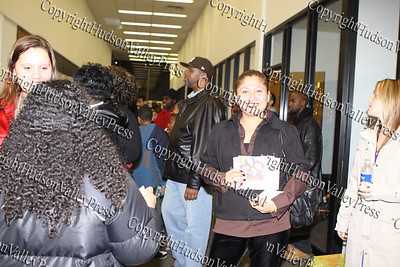 Blanca Colon of Hudson Health Plan hands out information during the City of Newburgh Christmas Extravaganza held at the Business Resource Center on December 12, 2008.