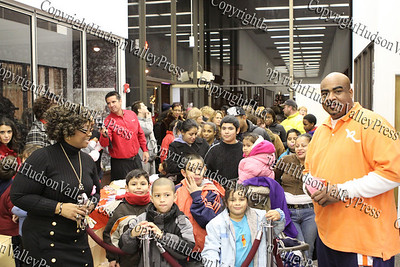 Rhonda Green and Derick Walters control the hundreds of children waiting in line to see Santa at the City of Newburgh Christmas Extravaganza held at the Business Resource Center on December 12, 2008.