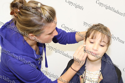 Meghan Rescoe of YAP, paints 10-year-old Alexis face at the City of Newburgh Christmas Extravaganza held at the Business Resource Center on December 12, 2008.
