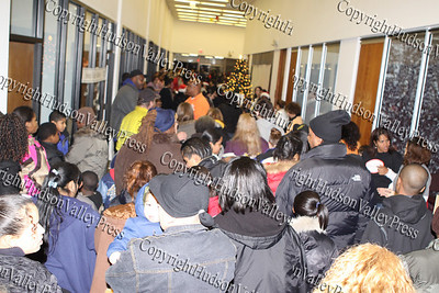 The long line of people that gathered City of Newburgh Christmas Extravaganza held at the Business Resource Center on December 12, 2008..