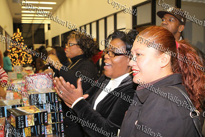 Rhonda Green, Joy Pittman, Blanca Colon watch as bicycles are given away at the City of Newburgh Christmas Extravaganza held at the Business Resource Center on December 12, 2008.