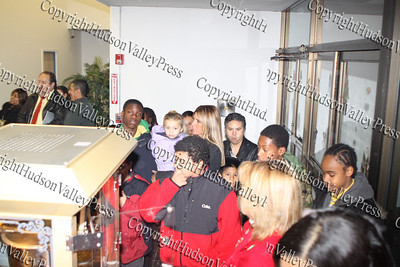Children line up for popcorn at the City of Newburgh Christmas Extravaganza held at the Business Resource Center on December 12, 2008.