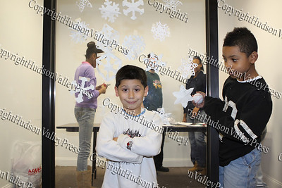 A young man poses for a picture after making a snow flake at the City of Newburgh Christmas Extravaganza held at the Business Resource Center on December 12, 2008.