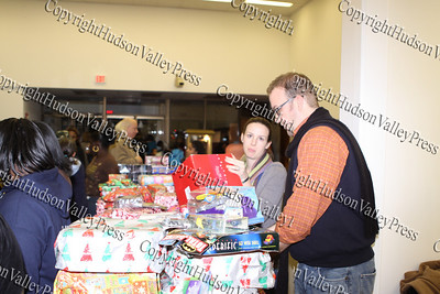 David DesLauriers of Planned Parenthood Mid-Hudson Valley prepares to hand out gifts during the City of Newburgh Christmas Extravaganza held at the Business Resource Center on December 12, 2008.