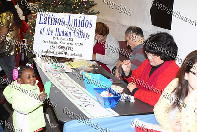 Latinos Unidos of the Hudson Valley book made bookmarks for children during the City of Newburgh Christmas Extravaganza held at the Business Resource Center on December 12, 2008.