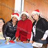 Workers of the Healthy Families booth pose for a picture at the City of Newburgh Christmas Extravaganza held at the Business Resource Center on December 12, 2008.