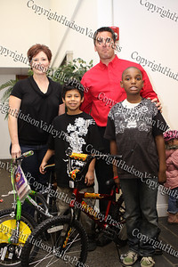State Farm agents Sue Zaleski and Steve Cooney pose with children who received bicycles they donated for the City of Newburgh Christmas Extravaganza held at the Business Resource Center on December 12, 2008.