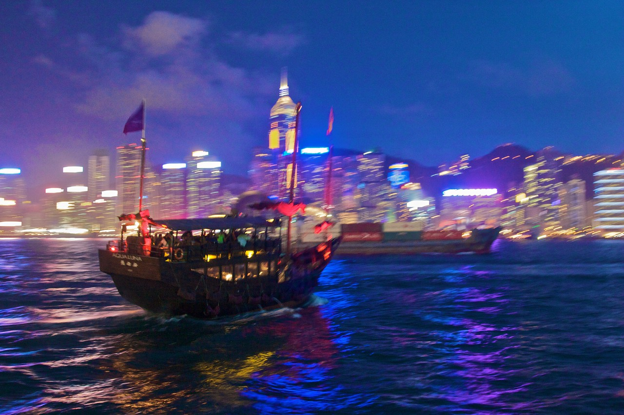 Junk • It may be blurred (it was very windy at the time), but I like the colours in this photo of a pleasure boat crossing Victoria harbour.