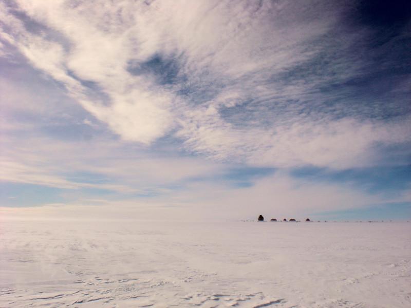 Beautiful clouds and the camp in the horizon.<br /> <br /> Smukke skyer og lejren i horisonten.