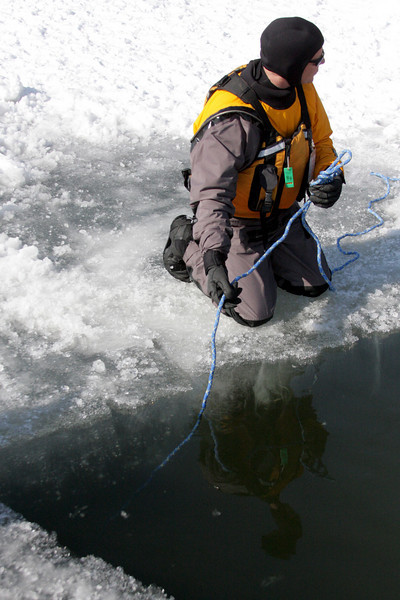 There's a living, breathing human being at the end of this rope, deep under the frozen ice.