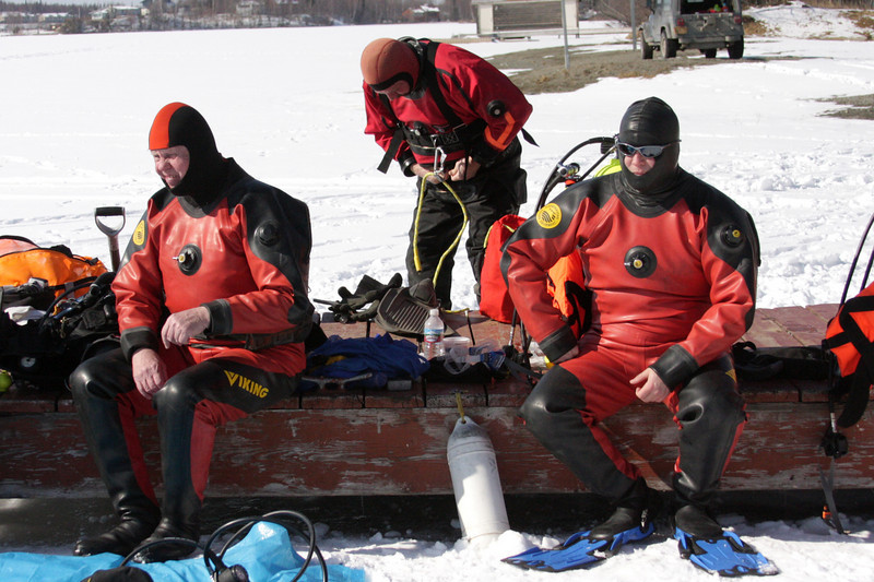 Divers Walt Gilmore, Mike Klawitter, and Casey Cook prepare to get in the water.
