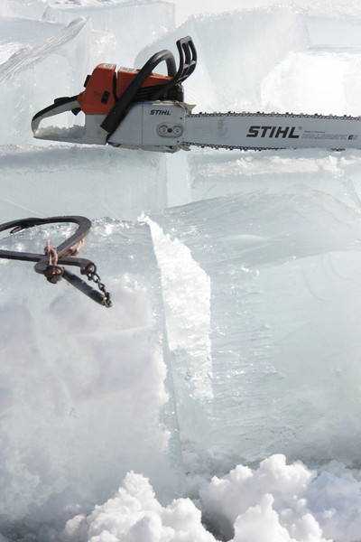 Tools of the trade: our ice cutting implements take a break, resting on the blocks of ice they removed from the lake.